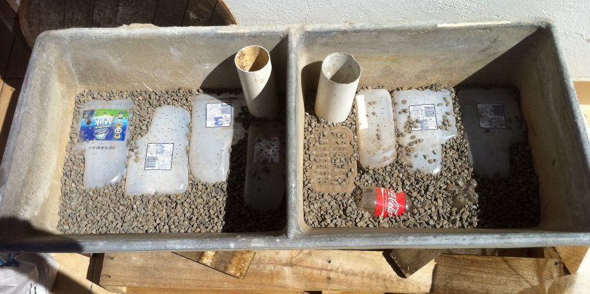 The reservoir of sub-irrigated concrete basin planter levelled with gravel