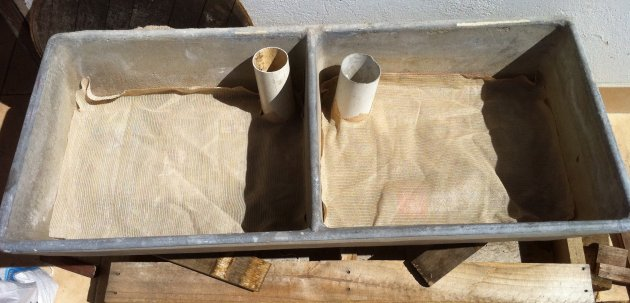 Shade cloth used to separate soil from reservoir in sub-irrigated planter