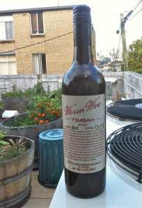 Bottle of Worm Wee in the garden